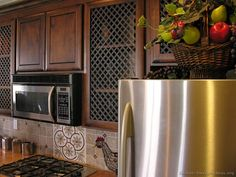 #Kitchen Idea of the Day: Classic Dark Walnut-Colored Kitchen with wire grille cabinet doors.