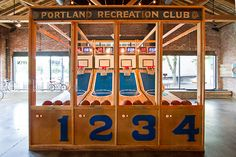 The hand-built basketball arcade was made with the repurposed high school gymnasium flooring.