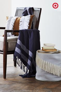 Nate Berkus' spring collection is all about woven textures and fringed details. From pillows and throws to a chic basket, mix in one statement piece—or deck out an entire room. Because when it comes to fringe, we like to think there's no such thing as too much.