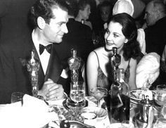 Larry, Vivien, Oscars 3, Johnnie Walker, and multiple glassware styles at a table in the Cocoanut Grove. The 1939 Academy Awards.