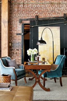 Industrial loft office with blue velvet chairs designed by William Peace
