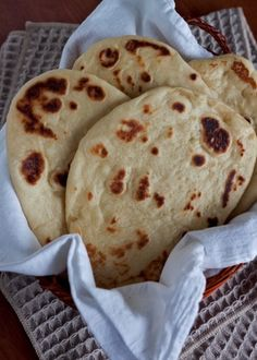 Naan - an easy to make Indian Flatbread that is ready to eat, fresh and hot from the oven in about an hour using Quick Rise Yeast and a mixer to do the kneading for you.