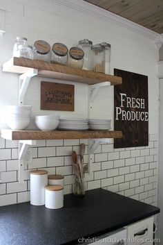 DIY Farmhouse Kitchen Makeover. AMAZING transformation! Love the reclaimed wood open shelving, subway tile, black granite counters,  wood ceiling...