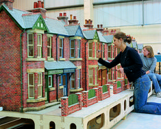 "The Cod Steaks team working on one of the street sets for the Aardman feature film ""Wallace & Gromit: The Curse of the Were-Rabbit"" #wallaceandgromit #modelmaking"