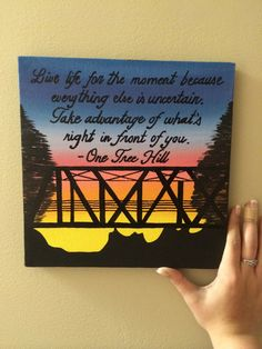 This is a painting that I did after the show One Tree Hill. It features the iconic bridge from the opening credits. The font pictured is just