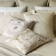 Kelly Wearstler for Sferra, Quartz pillow features swirls of marble printed in a soft gold metallic on linen