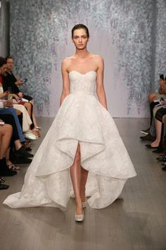 15 gorgeous new wedding dresses from the fall 2016 collections, including this Monique Lhuillier strapless style with a hi-low hemline