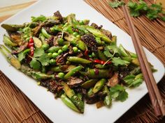 Asparagus, fresh fava beans, English peas, snap peas, and morel mushrooms might not be typical menu items at your average Chengdu greasy spoon—but hey, we've managed to transform Western broccoli into the most common vegetable on the takeout menu, so why not branch out even further? This stir-fry uses the best Western spring produce and Chinese techniques and flavors for a unique dish to brighten up your table.