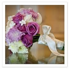 purple and white flowers:    Her flowers included roses, hydrangea, stephanotis, mums, and cymbidium orchids