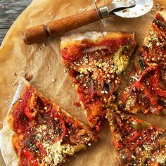 The best and easiest vegan pizza with a garlic-herb crust, simple tomato sauce, loads of sauteed veggies and vegan parmesan cheese!