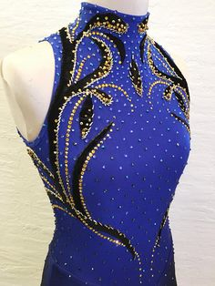 X Costume Designs Stock Dress Ombre Skating dress with black and gold vine design. This dress is decorated with hand cut velvet appliqué, hand beading and Swarovski crystals. Double layer lycra skirt that comes to a point both in front and back. Measuments Bust 34-36 Waist 27-29
