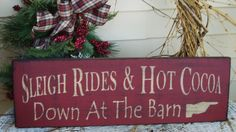 Sleigh Rides and Hot Cocoa down at theBarn primitive wood Christmas sign. $24.00, via Etsy.