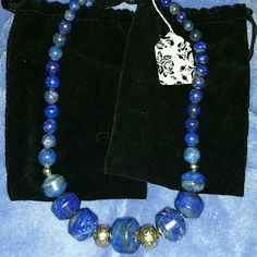 Jay King lapis necklace/sterling *NEW* I bought this chunky Jay king. Lapis necklace and thought it needed something so I added. Some chunky sterling beads and 2 smaller sterling beads. Made a difference. I'm a jewelry designer and make, sell my jewelry. If you're not happy with the change I'm happy to take the sterling out. Pls let me know Jay King  Jewelry Necklaces