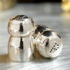 Here's a special addition to the dining table, a champagne cork salt and pepper set by Culinary Concepts. The perfect cruet set for champagne lovers, collectors or the person who has everything. Beautifully designed and finished in silver plate, this is a keepsake piece to have and to use forever. An ideal Wedding or Anniversary gift also. Gift boxed.