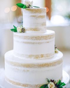 33 Romantic Wedding Cakes | Martha Stewart Weddings - This partly naked violet-lavender cake was designed by Colorado Rose Cake Company. The three-tiered confection was simply adorned with a few fresh flowers for a subtle but totally elegant look.