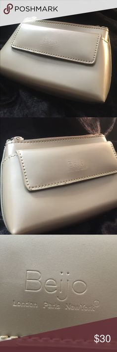 Beijo pearlescent patent leather wallet clutch. Beijo London, Paris, New York pearlescent off white polyurethane type material wallet clutch with silver zipper pull. Very adorable and in perfect condition. Beijo Bags Clutches & Wristlets