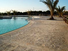 great swimmingpool - stamped #concrete floor, rocky effect http://www.idealwork.com/Stamped-concrete-Features-and-benefits.html
