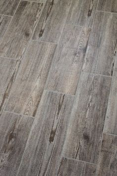 Bathroom tile that resembles old wood. Love these tiles!