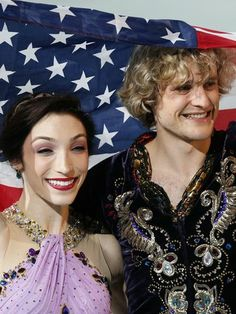 Feb 17, 2014; Sochi, RUSSIA; Charlie White and Meryl Davis (USA) celebrate winning the gold medal in ice dance free dance program during the...