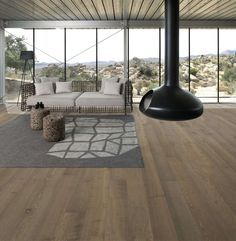 The light smoked matt lacquer of Kahrs Oak Nouveau Greige protects the textured planks and helps to enhance the rustic grain of the wood. Get 30 years manufacturers warranty for domestic installations of the Kahrs oak Nouveau Greige engineered wood flooring.