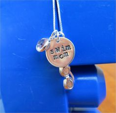Swim mom necklace with sterling silver hand stamped charm, swim goggles and Swarovski birthstone accent