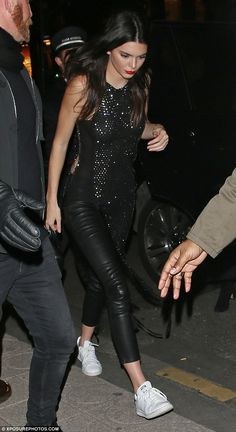 Off duty: The 20-year-old model showed off her figure in leather trousers teamed with a sparkly top