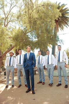 """The of July Wedding of Plain White T's Guitarist Tim Lopez Jenna Reeves and Tim Lopez are just like any other couple. """"We were introduced the same way most [people] meet in Los Angeles: filming a reality TV show,"""" Tim jokes. As a member of the . Groomsmen Attire Grey, Groomsmen Suspenders, Groomsmen Outfits, Bridesmaids And Groomsmen, Groomsman Attire, Mismatched Groomsmen, Blue Groomsmen Suits, Blue Suit Groom, Groom Attire Rustic"""