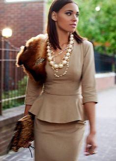 Tan skirt suit. Fur shawl. Pearls. Sophistication.