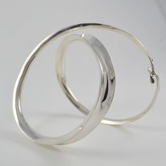 This is beautiful sterling silver bracelet from Savi is very elegant and modern as it twists around your arm.