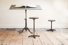 USA, 1880s, Vintage Industrial Winnblat Zinc Top Drawing Table. Heavy Cast Iron Swag Leg Base with a Zinc covered Wooden Top. Fully Adjustable --Tilt, Swivel, and Height. Worn Pewter Finish on Iron Base. The Zinc Top shows Beautiful Time Worn Oxidation. Generous Size. Extremely Functional Table.   factory20.com