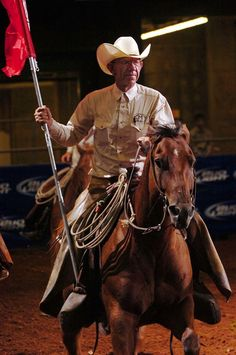 O wow - this was a surprise to see on pintrest Tom Moorhouse of the Tongue River Ranch rides into the arena carrying the Ranch Roundup flag Saturday night for the 30th Texas Ranch Roundup. Moorhouse has participated in every roundup since the beginning in 1981.