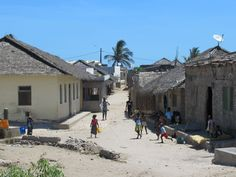 Thatched houses are the norm in Makuti Town in the southern part of Mozambique Island. Much of the population earns its livelihood from fishing. Mozambique Beaches, World Of Wanderlust, Thatched House, East Africa, Beach Resorts, Portuguese, Adventure Travel, Street View, Island