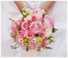 A sweet looking bouquet of pink peonies, pink roses, white lisianthus and ornithogalums.