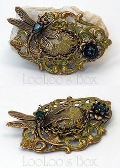 A fabulous brooch made from a vintage style brooch finding, accented with a delightful dragonfly.  From Robin Delargy, of LooLoo's Box at Etsy.