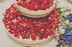 Strawberry cheesecake wedding cake. Or maybe plain with toppings on the side?