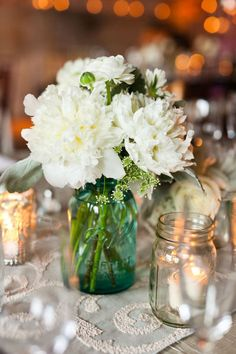 White flowers with blue mason jar. So pretty and country. #Weddings #mason jars #smoky mountains