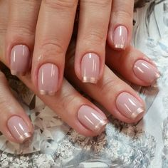 Elegant looking nude and gold spring nail art design. Make your nails look brand new and fresh with this nail art design and with the help of the gold glitter French tips.
