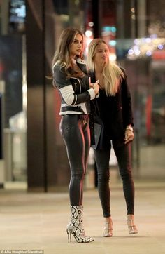 Stunning: The beauty slipped into some black, skintight wet-look leggings for her night at...