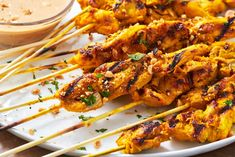 Satay is a popular Southeast Asian street food that usually involves a marinated meat being skewered and grilled, then served with a simple saucy dip. We're using flavourful chicken thigh meat here, … Chicken Bacon Ranch, Baked Chicken, Chicken Recipes, Recipe Chicken, Grilled Chicken, Chicken Satay, Chicken Skewers, Chicken Wings, Receta Bbq