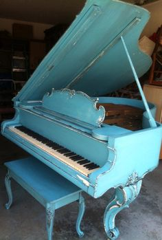 This is a 1915 C. Kurtzmann Baby Grand piano. Painted in turquoise and distressed and a ebony briwax.