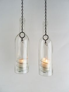 Two Clear Glass Wine Bottle Candle Holder Hanging Hurricane Lanterns. $36.00, via Etsy.