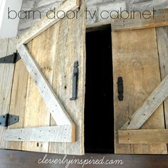 Barn Door TV Cabinet above Mantle - Cleverly Inspired