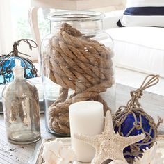 Rope in a jar would look great next to the starfish in the lantern. master bath