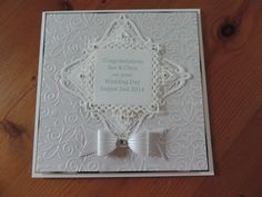 Wedding day using Sue Wilson bow, spellbinder dies & tattered lace fretwork embossing folder