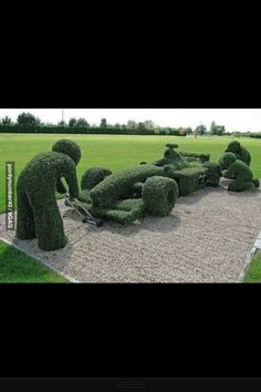 Fabulous garden sculpture of an F1 car! Brilliant this is a real green car