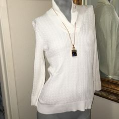 White sweater Never worn. Long sleeves, light weight perfect under a jacket. Not too bulky! Necklace also for sell. Check in my closet Pria Sweaters