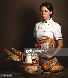 Stock Photo : Baker holding in hands fresh baked bread.