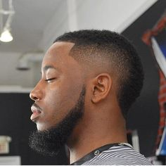 The South of France is the official name of the Usher haircut. It is a burst fade haircut that leaves a wide mohawk. Hair on top can be shorter or longer. The South of France haircut