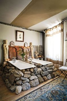Unusual but still beautiful; double baths and Catholic paraphernalia in the bathroom of the Aubrac room at L'Annexe d'Aubrac, Aveyron, France  Image credit - www.cntraveller.com