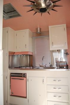 1961 Holiday House kitchen. Love it!!! A stunning vintage pink kitchen... in a vintage trailer... so so cute!